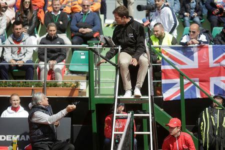 Romania's head coach Ilie Nastase talks to the chair umpire during the FedCup Group II play-off match between Romania and Great Britain, in Constanta county, Romania, April 22, 2017. Inquam Photos/George Calin/via REUTERS