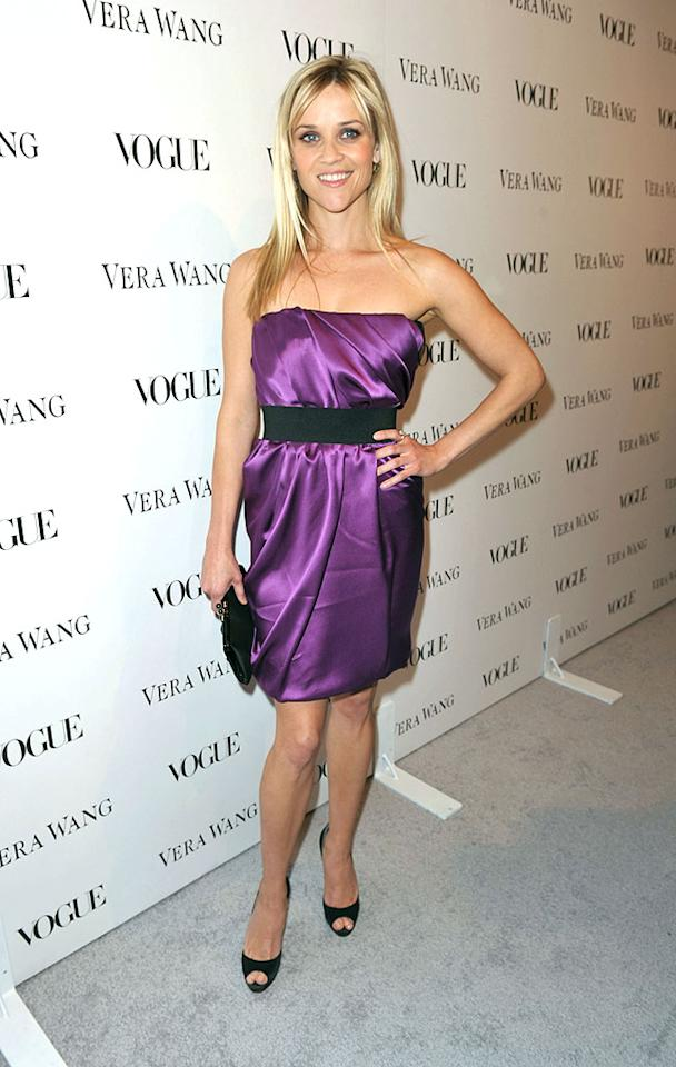 "Single and simply gorgeous, Reese Witherspoon flaunted her fab figure in a curve-hugging purple satin Vera Wang mini at Wang's store launch in Los Angeles. Jake who? John Shearer/<a href=""http://www.wireimage.com"" target=""new"">WireImage.com</a> - March 2, 2010"