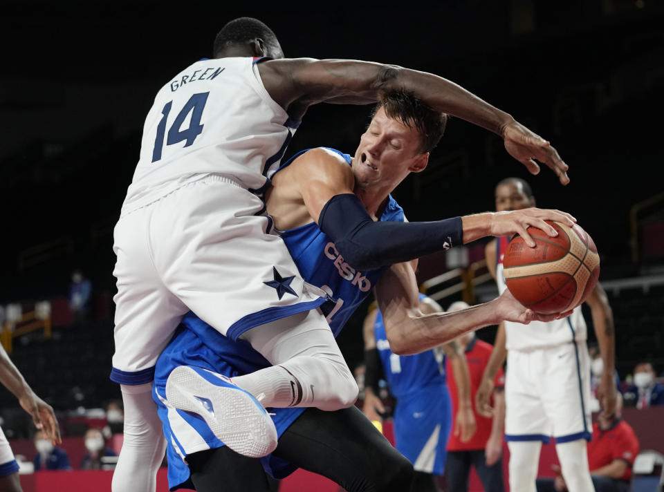 Czech Republic's Jan Vesely (24) is defended and fouled by United States's Draymond Green (14) during a men's basketball preliminary round game at the 2020 Summer Olympics, Saturday, July 31, 2021, in Saitama, Japan. (AP Photo/Eric Gay)