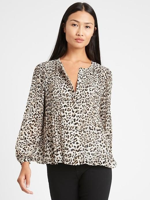 <p>Take a walk on the wild side with the animal print of this <span>Banana Republic Print Pleated Shirt</span> ($21, originally $90).</p>