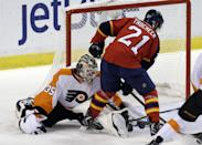Philadelphia Flyers goalie Steve Mason (35) blocks Florida Panthers center Vincent Trocheck (21) as he tries to score in the first period of an NHL hockey game in Sunrise, Fla., Saturday, Nov. 1, 2014. (AP Photo/Alan Diaz)