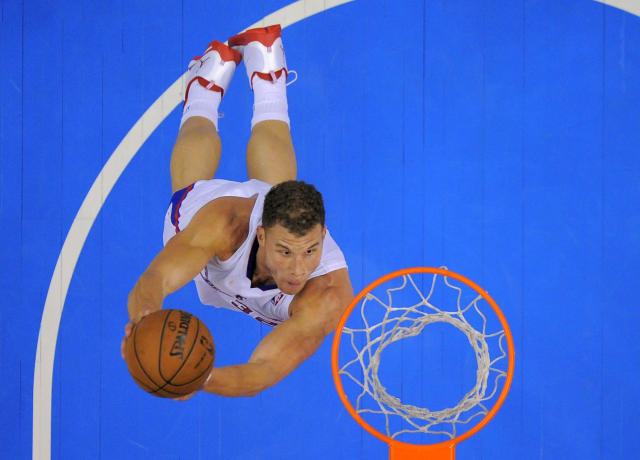 Los Angeles Clippers forward Blake Griffin goes up for a dunk during the second half of an NBA basketball game against the Utah Jazz, Saturday, Dec. 28, 2013, in Los Angeles. (AP Photo/Mark J. Terrill)