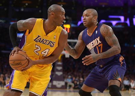Dec 10, 2013; Los Angeles, CA, USA; Los Angeles Lakers guard Kobe Bryant (24) is defended by Phoenix Suns forward P.J. Tucker (17) at Staples Center. Kirby Lee-USA TODAY