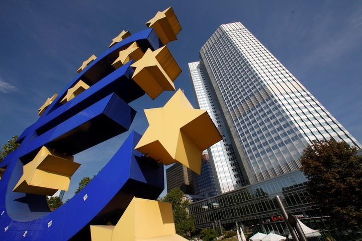 FILE PHOTO: A huge Euro logo is pictured by the headquarters of the European Central Bank (ECB) in Frankfurt