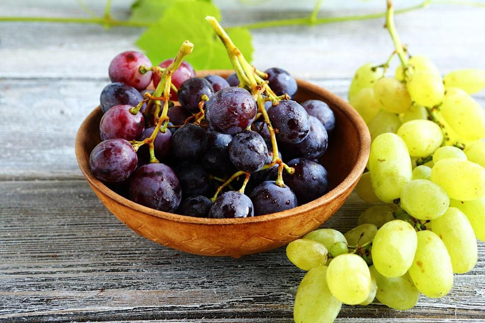 """<p>The juicy fruits are packed with the antioxidant resveratrol, which <a href=""""http://www.ncbi.nlm.nih.gov/pmc/articles/PMC2728696/"""" rel=""""nofollow noopener"""" target=""""_blank"""" data-ylk=""""slk:research suggests"""" class=""""link rapid-noclick-resp"""">research suggests </a>could play a role in thwarting the development of stomach, breast, liver, and lymphatic cancers. One thing to keep in mind? When it comes to cancer prevention, whole grapes are probably a better choice than red wine. Even though vino's got resveratrol too, <a href=""""https://www.prevention.com/health/health-conditions/a19676118/long-term-effects-of-alcohol/"""" rel=""""nofollow noopener"""" target=""""_blank"""" data-ylk=""""slk:alcohol consumption"""" class=""""link rapid-noclick-resp"""">alcohol consumption</a> can up your cancer risk, <a href=""""https://www.cdc.gov/cancer/alcohol/index.htm"""" rel=""""nofollow noopener"""" target=""""_blank"""" data-ylk=""""slk:the CDC"""" class=""""link rapid-noclick-resp"""">the CDC</a> says. </p><p><strong>Try it:</strong> <a href=""""https://www.prevention.com/food-nutrition/recipes/a20493176/chicken-waldorf-tacos/"""" rel=""""nofollow noopener"""" target=""""_blank"""" data-ylk=""""slk:Chicken Waldorf Tacos"""" class=""""link rapid-noclick-resp"""">Chicken Waldorf Tacos</a></p>"""