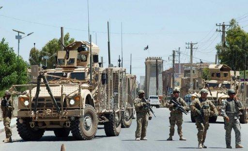US Soldiers stop traffic leading to the governor's compound in Kandahar. Two bodyguards and two suicide attackers have been killed in a gun battle inside the the compound, an official said