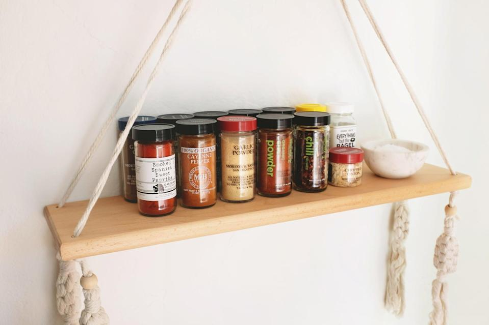 <p>This hanging wall shelf is a major upgrade from a traditional spice rack. Hang it within arm's reach from where you do your cooking to master the next viral TikTok recipe. Line up your spices and add a small bowl for whenever you need a pinch of salt.</p>