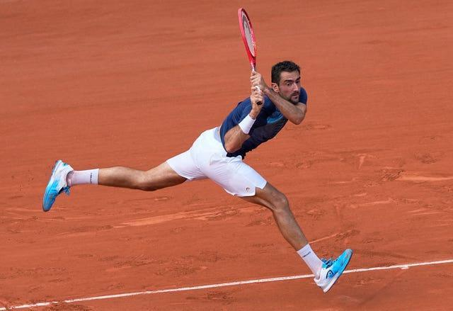 Marin Cilic plays a backhand at full stretch during his loss to Roger Federer