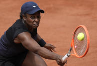United States's Sloane Stephens plays a return to Czech Republic's Karolina Muchova during their third round match on day 7, of the French Open tennis tournament at Roland Garros in Paris, France, Saturday, June 5, 2021. (AP Photo/Christophe Ena)