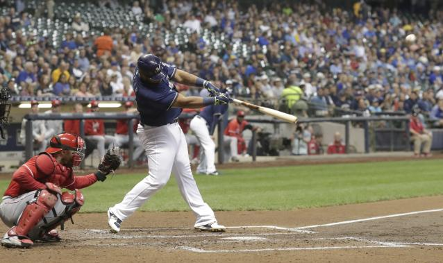 Milwaukee Brewers' Jesus Aguilar hits a three-run home run during the third inning of a baseball game against the Cincinnati Reds Wednesday, Sept. 19, 2018, in Milwaukee. (AP Photo/Morry Gash)
