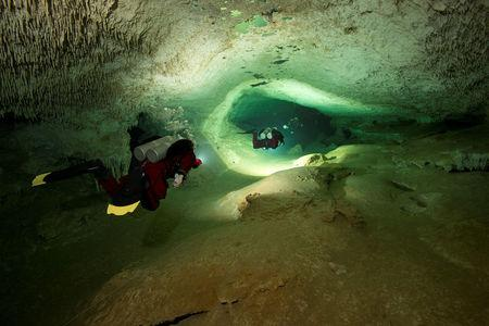 Scuba divers tour an authorized area of Sac Aktun underwater cave system as part of the Gran Acuifero Maya Project near Tulum, in Quintana Roo state, Mexico January 24, 2014.  Herbert Mayrl/Courtesy Gran Acuifero Maya Project (GAM)/Handout via REUTERS