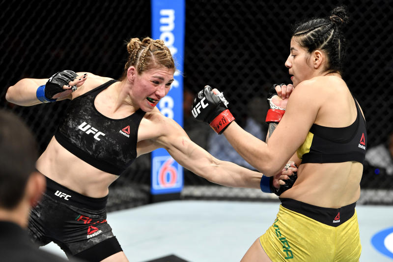 LAS VEGAS, NEVADA - DECEMBER 14: (L-R) Irene Aldana of Mexico strikes Ketlen Vieira of Brazil in their women's bantamweight bout during the UFC 245 event at T-Mobile Arena on December 14, 2019 in Las Vegas, Nevada. (Photo by Jeff Bottari/Zuffa LLC)