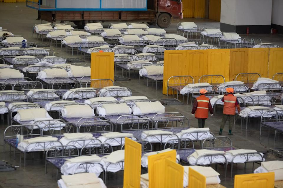 Empty beds seen in a huge hall at a makeshift medical centre in a Wuhan exhibition centre.