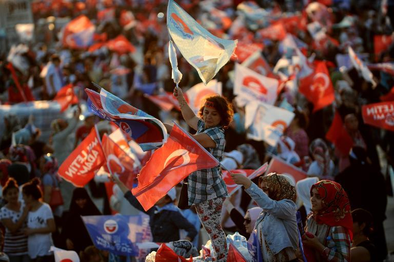 Supporters of the Turkish Prime Minister and Presidential candidate wave Turkish flags during a rally on August 3, 2014 in Istanbul
