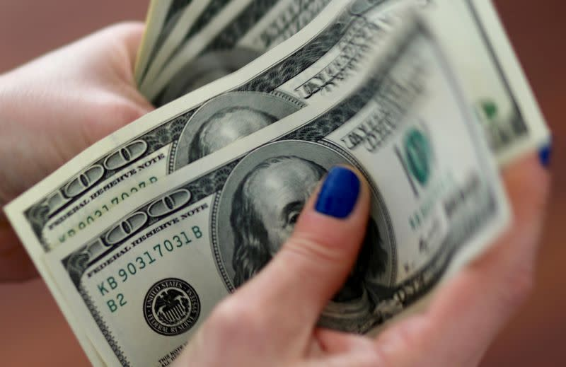 Dollar holds gains as coronavirus woes sap confidence
