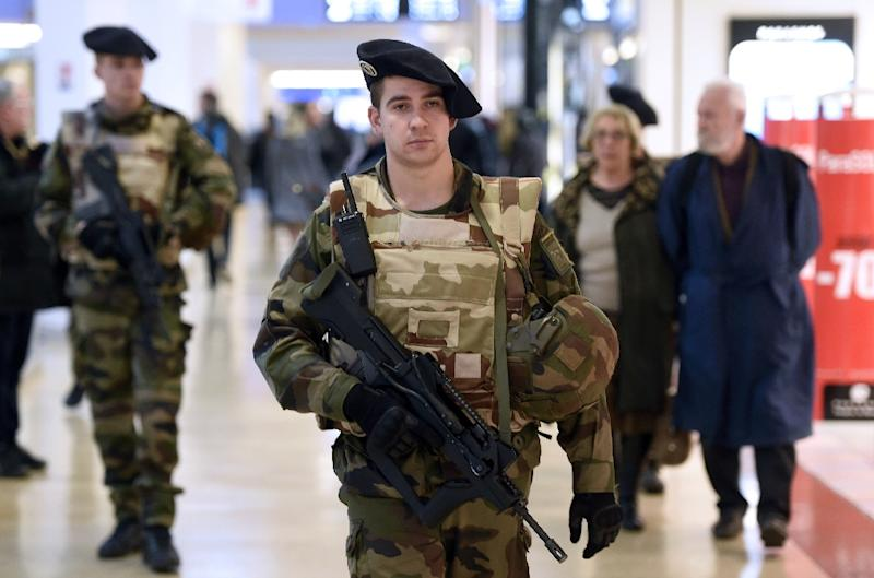 French soldiers patrol in a shopping center in Lyon on January 16, 2015