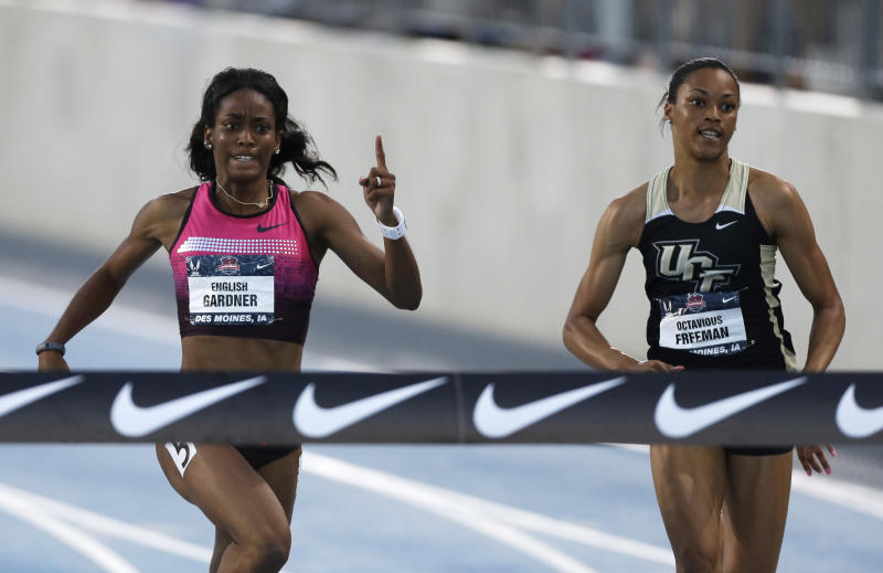 English Gardner, left, defeats Octavious Freeman to the finish line in the senior women's 100-meter dash final at the U.S. Championships athletics meet, Friday, June 21, 2013, in Des Moines, Iowa. Gardner won the race in 10.85 seconds. (AP Photo/Charlie Neibergall)