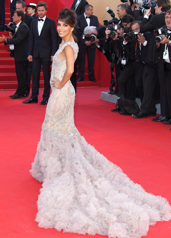 "Eva Longoria kicked off this year's Cannes Film Festival in style when she hit the red carpet for the opening ceremony (and <a target=""_blank"" href=""http://movies.yahoo.com/movie/moonrise-kingdom/"">""Moonrise Kingdom""</a> premiere) in a breathtaking Marchesa gown. Surprisingly, the dress -- which featured a 10 foot tulle train -- didn't overwhelm the diminutive ""Desperate Housewives"" alumna, who also donned a chic updo and simple diamond earrings. (5/16/2012)<br><br>Head over to <a target=""_blank"" href=""http://www.whosay.com/EvaLongoria"">Eva's WhoSay page</a> for more pics of her Cannes red carpet prep!<br><br><a target=""_blank"" href=""http://bit.ly/lifeontheMlist"">Follow 2 Hot 2 Handle creator, Matt Whitfield, on Twitter!</a>"