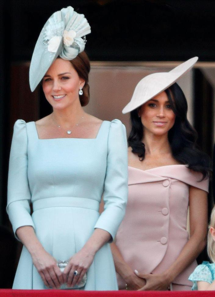 <p>For Meghan Markle's first Trooping the Colour after joining the royal family, she and sister-in-law Kate Middleton both chose monochrome looks: Meghan in blush, Kate in sky blue. </p>