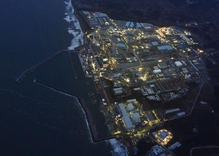 Tokyo Electric Power Co.'s (TEPCO) tsunami-crippled Fukushima Daiichi nuclear power plant is illuminated for decommissioning operation in the dusk in Okuma town, Fukushima prefecture, Japan, in this aerial view photo taken by Kyodo March 10, 2016, a day before the five-year anniversary of the March 11, 2011 earthquake and tsunami disaster. Mandatory credit REUTERS/Kyodo  ATTENTION EDITORS - FOR EDITORIAL USE ONLY. NOT FOR SALE FOR MARKETING OR ADVERTISING CAMPAIGNS. MANDATORY CREDIT. JAPAN OUT. NO COMMERCIAL OR EDITORIAL SALES IN JAPAN.  THIS IMAGE WAS PROCESSED BY REUTERS TO ENHANCE QUALITY, AN UNPROCESSED VERSION WILL BE PROVIDED SEPARATELY.            TPX IMAGES OF THE DAY      - RTSA5TX