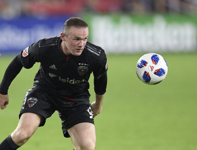 FILE - In this file photo dated Sunday, Aug. 12, 2018, D.C. United forward Wayne Rooney, in action against Orlando City during the second half of an MLS soccer match, in Washington, USA. It is announced Tuesday Aug. 6, 2019, that 33-year old former England captain Wayne Rooney will be leaving US Major League Soccer to join second-tier English Championship team Derby County as player-coach from January 2020. (AP Photo/Nick Wass, FILE)