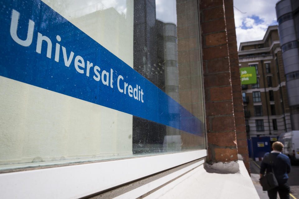 "LONDON, ENGLAND - MAY 03: A Universal Credit sign in the window of the Job Centre in Westminster on May 3, 2016 in London, England. The Resolution Foundation, chaired by former Conservative Minister David Willets, has said the Government's benefit reform has ""veered off track"" due to cost-cutting.  They say that 2.5 million families could be worse off, some by over ��3,000 a year. Universal Credit is a single payment and replaces six current benefits, including Jobseeker's Allowance and Employment and Support Allowance. (Photo by Jack Taylor/Getty Images)"
