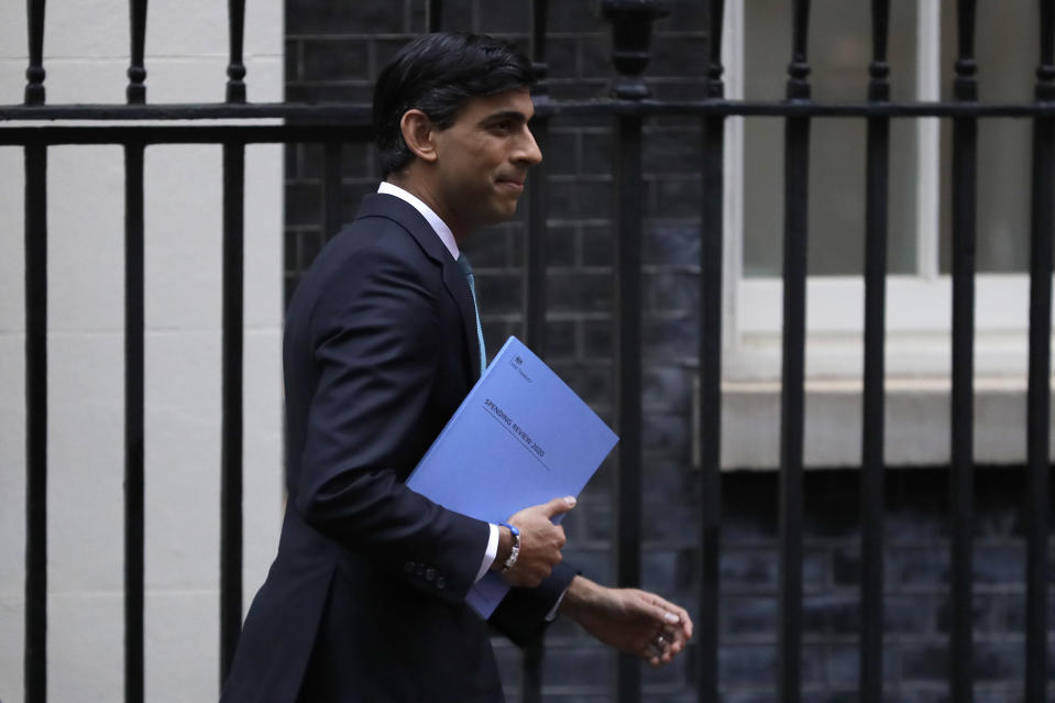 Britain's Chancellor Rishi Sunak leaves Downing Street to attend Parliament in London, Wednesday, Nov. 25, 2020. Britain's Treasury chief is set to tell lawmakers later Wednesday that the deterioration in the public finances has been worse than at any time since wartime, but that now is not the time to announce widespread spending cuts and tax rises. (AP Photo/Kirsty Wigglesworth)