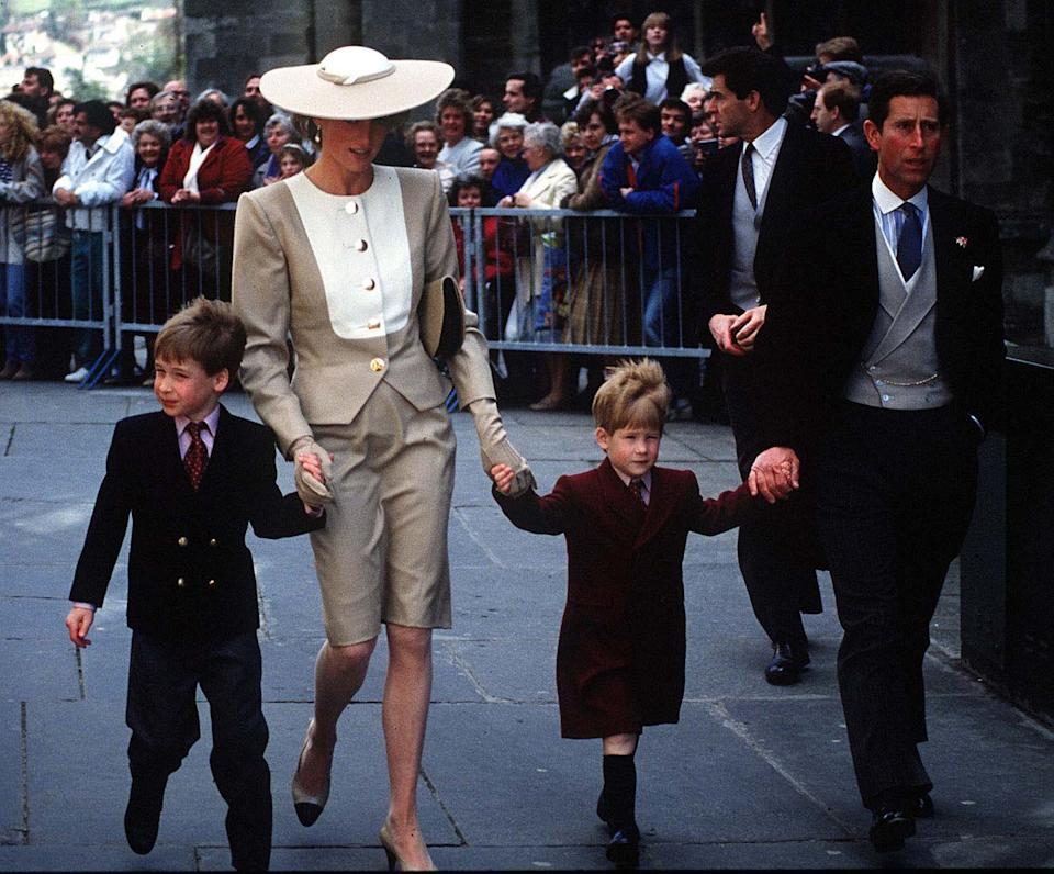 The Prince and Princess of Wales, with young Prince William and Harry at the wedding of Duke Hussey's daughter in Bath, May 1989.  Photo.  Anwar Hussein