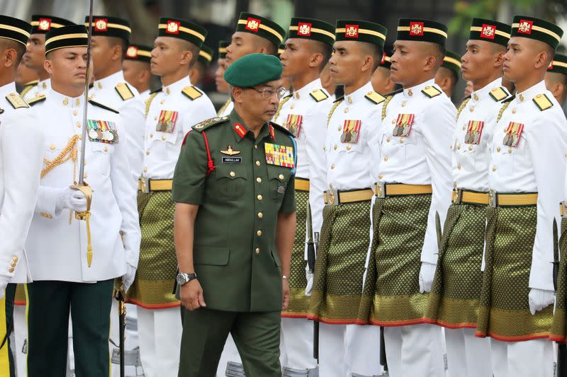 FILE PHOTO: Malaysia's King Al-Sultan Abdullah inspects guard of honour on Independence Day