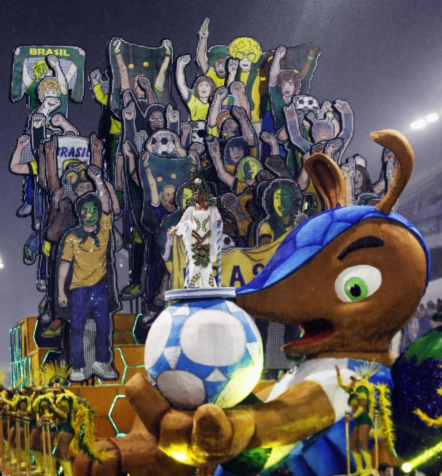 The official mascot of the FIFA 2014 World Cup, Fuleco the Armadillo, is seen in a float of Leandro de Itaquera samba school during the first night of the Special Group of the annual Carnival parade in Sao Paulo's Sambadrome February 28, 2014. REUTERS/Paulo Whitaker (BRAZIL - Tags: SOCIETY SPORT SOCCER WORLD CUP)