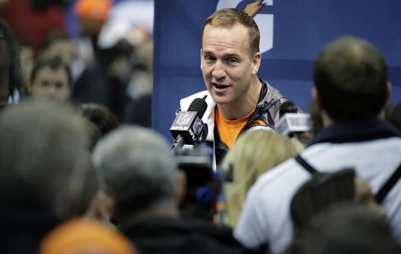 Denver Broncos' Peyton Manning answers questions during media day for the NFL Super Bowl XLVIII football game Tuesday, Jan. 28, 2014, in Newark, N.J. (AP Photo/Charlie Riedel)