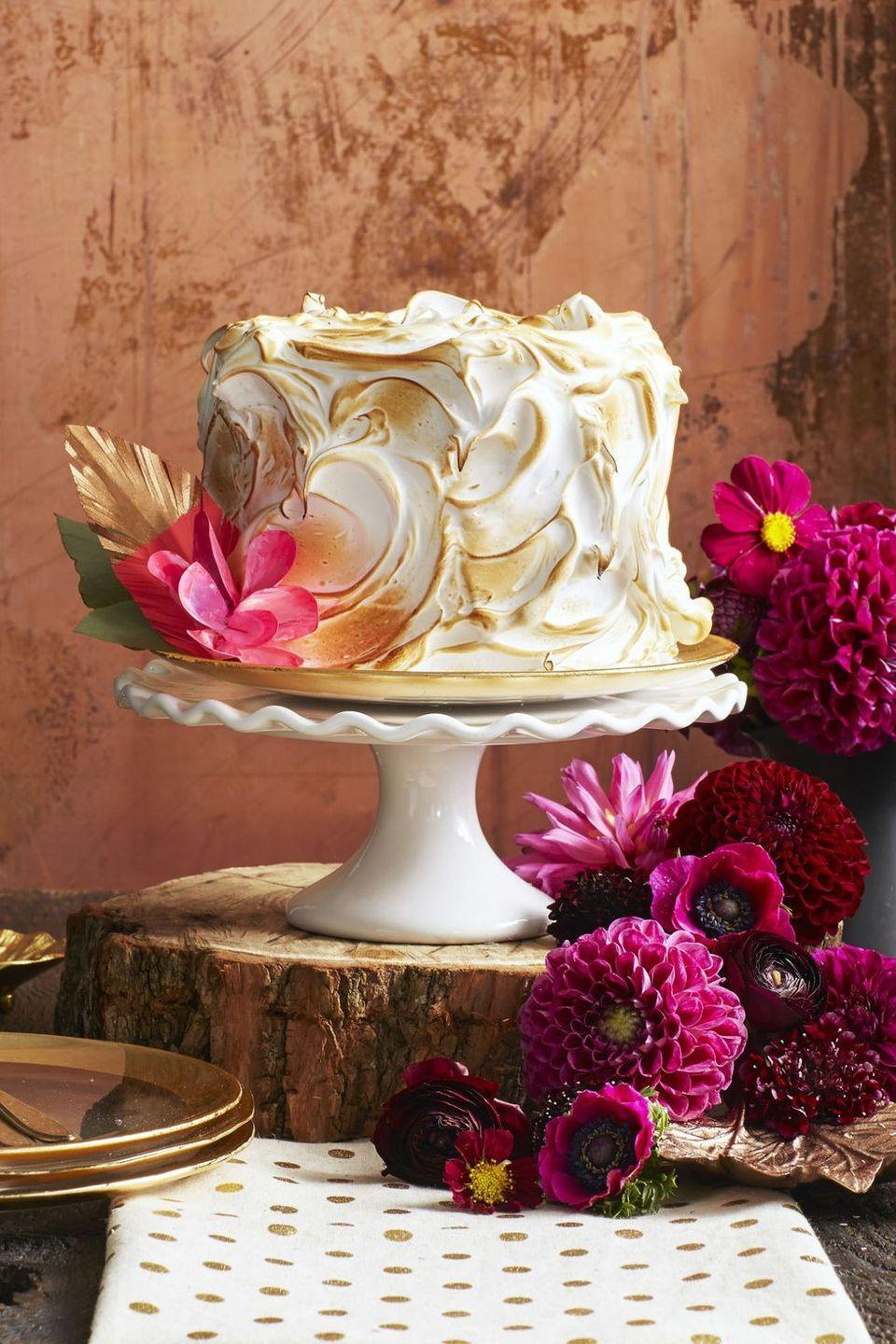 "<p>Feelin' extra about fall? Celebrate the season with this cream cheese-filled, fluffy meringue-topped cake.</p><p><em><a href=""https://www.goodhousekeeping.com/food-recipes/dessert/a35181/pumpkin-spice-cake/"" rel=""nofollow noopener"" target=""_blank"" data-ylk=""slk:Get the recipe for Pumpkin Spice Cake »"" class=""link rapid-noclick-resp"">Get the recipe for Pumpkin Spice Cake »</a></em></p>"