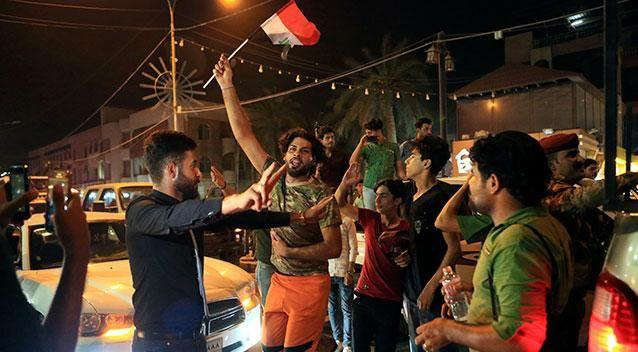 Iraqi citizens of Basra celebrate the news of their country's victory over Islamic State terrorists at Mosul. Photo: AP