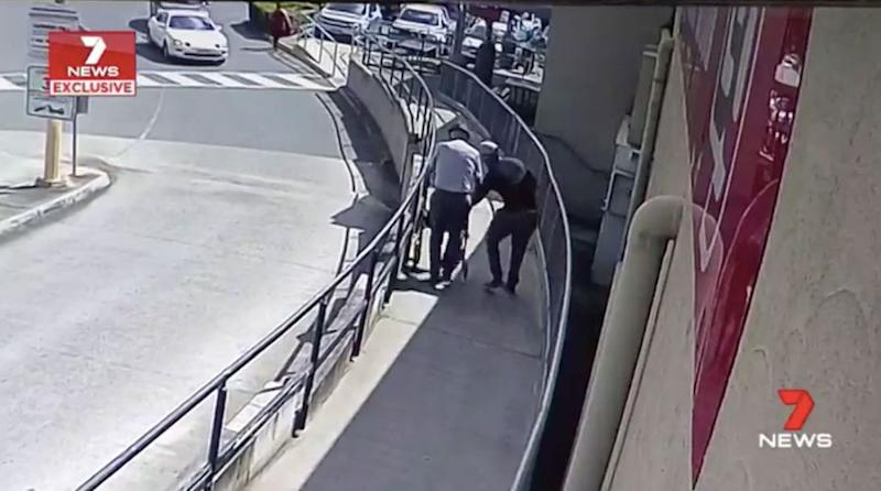 A man approaches 87-year-old Ray Browne. Source: 7 News