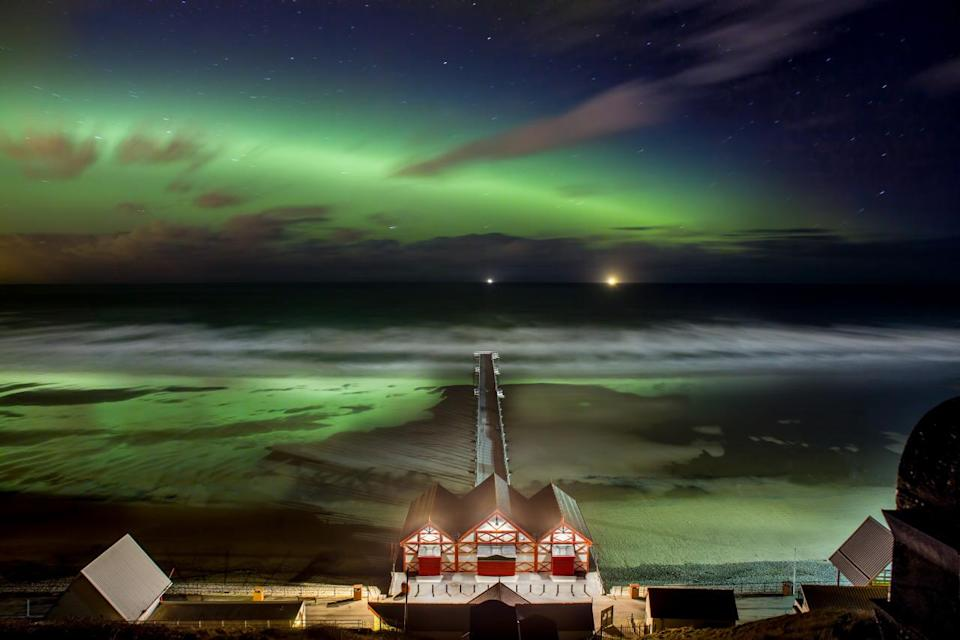 <p>An aurora was snapped over Saltburn pier, capturing the magnificent lime green colours reflecting in the waters. (Image: Trevor Shelley)<br></p>
