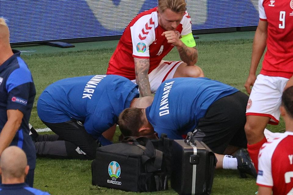 TOPSHOT - Denmark's defender Simon Kjaer (back) observes as paramedics attend to Denmark's midfielder Christian Eriksen (not seen) during the UEFA EURO 2020 Group B football match between Denmark and Finland at the Parken Stadium in Copenhagen on June 12, 2021. (Photo by WOLFGANG RATTAY / POOL / AFP) (Photo by WOLFGANG RATTAY/POOL/AFP via Getty Images) (Photo: WOLFGANG RATTAY via Getty Images)