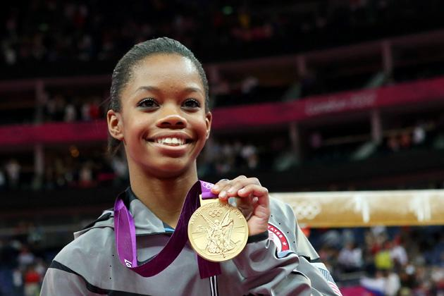 Gabrielle Douglas of the United States celebrates after winning the gold medal in the Artistic Gymnastics Women's Individual All-Around final on Day 6 of the London 2012 Olympic Games at North Greenwich Arena on August 2, 2012 in London, England.  (Photo by Ronald Martinez/Getty Images)