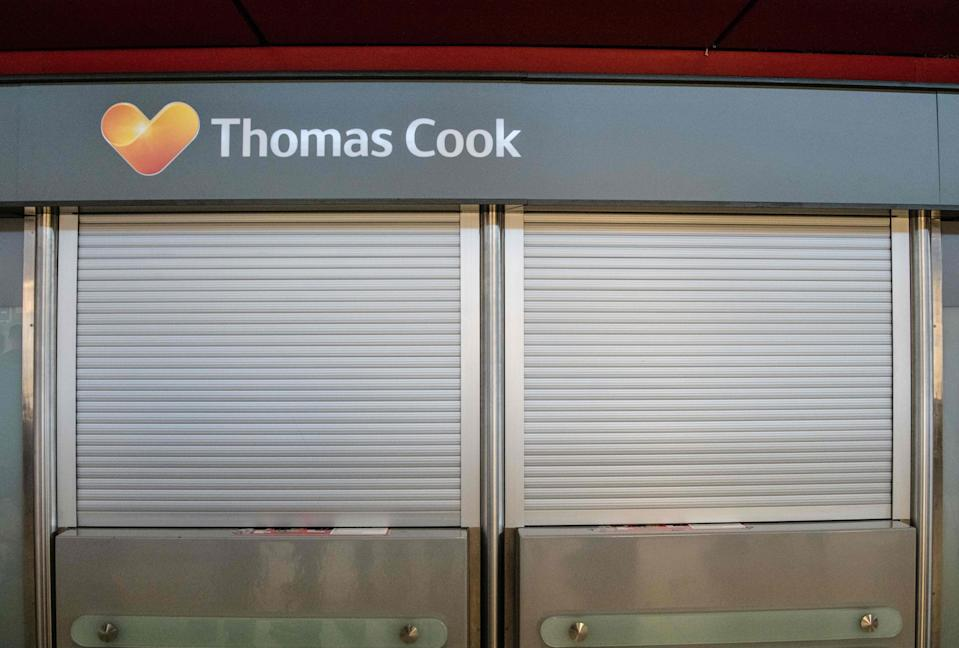 The service desk of British tour operator Thomas Cook is closed at Tegel airport in Berlin on September 23, 2019. - As British tour operator Thomas Cook declared bankruptcy, some 600,000 tourists from around Europe had their holidays disrupted. (Photo by Paul Zinken / dpa / AFP) / Germany OUT        (Photo credit should read PAUL ZINKEN/AFP/Getty Images)