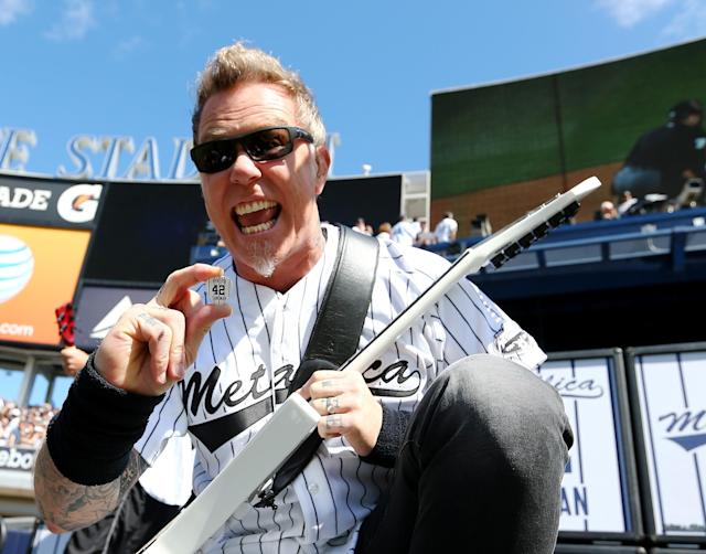 NEW YORK, NY - SEPTEMBER 22: James Hetfield of Metallica shows off his special guitar pick before they play Enter Sandman to honor pitcher Mariano Rivera #42 of the New York Yankees during the Mariano Rivera Day pregame ceremony before an interleague game against the San Francisco Giants on September 22, 2013 at Yankee Stadium in the Bronx borough of New York City. (Photo by Elsa/Getty Images)