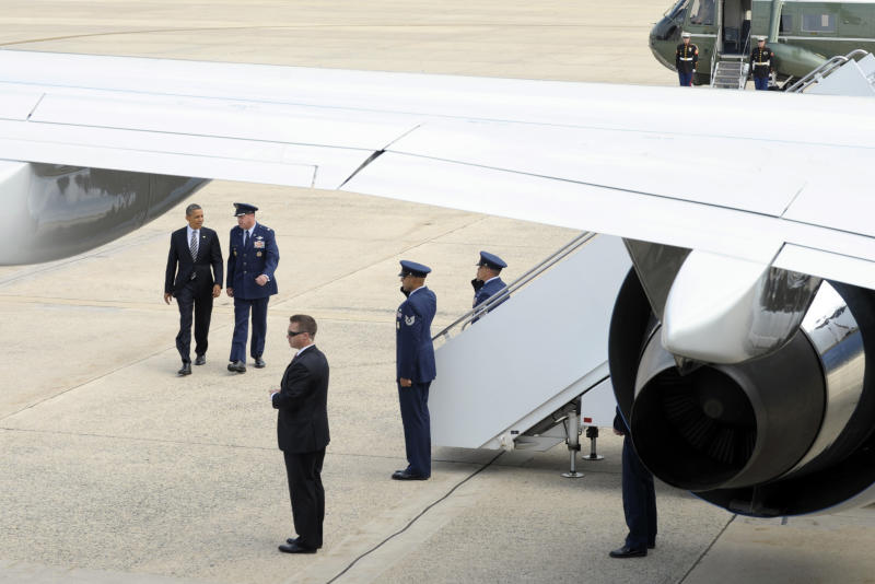 President Barack Obama walks to Air Force One at Andrews Air Force Base in Md., Friday, July 13, 2012, enroute to Virginia for a series of campaign events. (AP Photo/Susan Walsh)