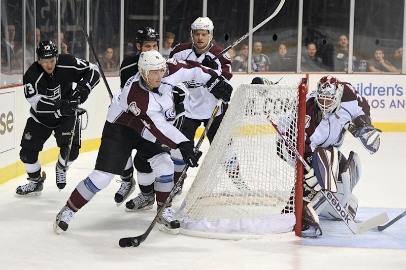 Colorado Avalanche defenseman Tyson Barrie (4) clears the puck around net in the second period of an NHL preseason hockey game against the Los Angeles Kings, Saturday, Sept. 28, 2013 in Las Vegas. (AP Photo/David Cleveland)