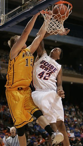 Wyoming's Adam Waddell (15) dunks against Boise State's Kenny Buckner (42) during the first half of an NCAA college basketball game on Saturday, Jan. 28, 2012 in Boise, Idaho. (AP Photo/Matt Cilley)