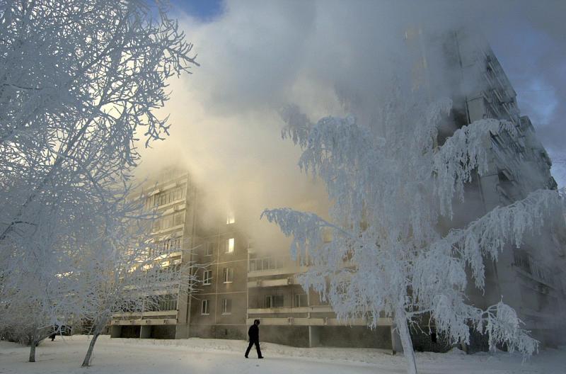 FILE - In this Thursday, Jan. 19, 2006 file photo ice covered trees in the city of Yekaterinburg, 1500 km (900 miles) east of Moscow, Thursday, Jan. 19, 2006. Russia has been treating its bid to hold the expo as a state priority not unlike its bids to host the Winter Games and the World Cup. Officials expect that hosting the expo in the Ural Mountains city of Yekaterinburg would cost Russia $4 billion, the local governor said last week, adding that half of it would come from the budget and the remaining half from private investors. The organizers are planning to build 103 pavilions for the expo and accommodation for exhibition participants, which will later be converted into a residential area. Russian officials said the expo will help to attract investors and their money to the Yekaterinburg area. (AP Photo/Alexei Vladykin/UralPress Photo, file)