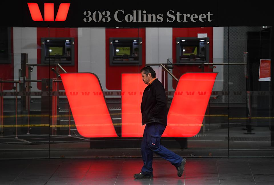 A man walks past a Westpac bank sign in Melbourne's central business district on May 4, 2020. - Westpac on May 4 announced its half-year net profit had fallen 62 percent, making it the latest Australian bank to see profits dive during the coronavirus crisis. (Photo by William WEST / AFP) (Photo by WILLIAM WEST/AFP via Getty Images)