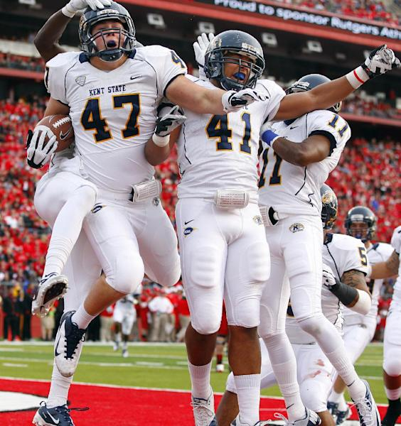 Kent State's Mark Fackler (47) celebrates his interception return for a touchdown with teammates Zack Hitchens (41) and Evan Shimensky (11) during the first half against Rutgers in an NCAA college football game in Piscataway, N.J., Saturday, Oct. 27, 2012. (AP Photo/Rich Schultz)
