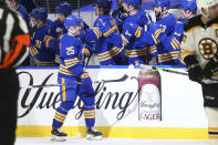 Buffalo Sabres forward Arttu Ruotsalainen (25) is congratulated after a goal during the second period of the team's NHL hockey game against the Boston Bruins, Thursday, April 22, 2021, in Buffalo, N.Y. (AP Photo/Jeffrey T. Barnes)