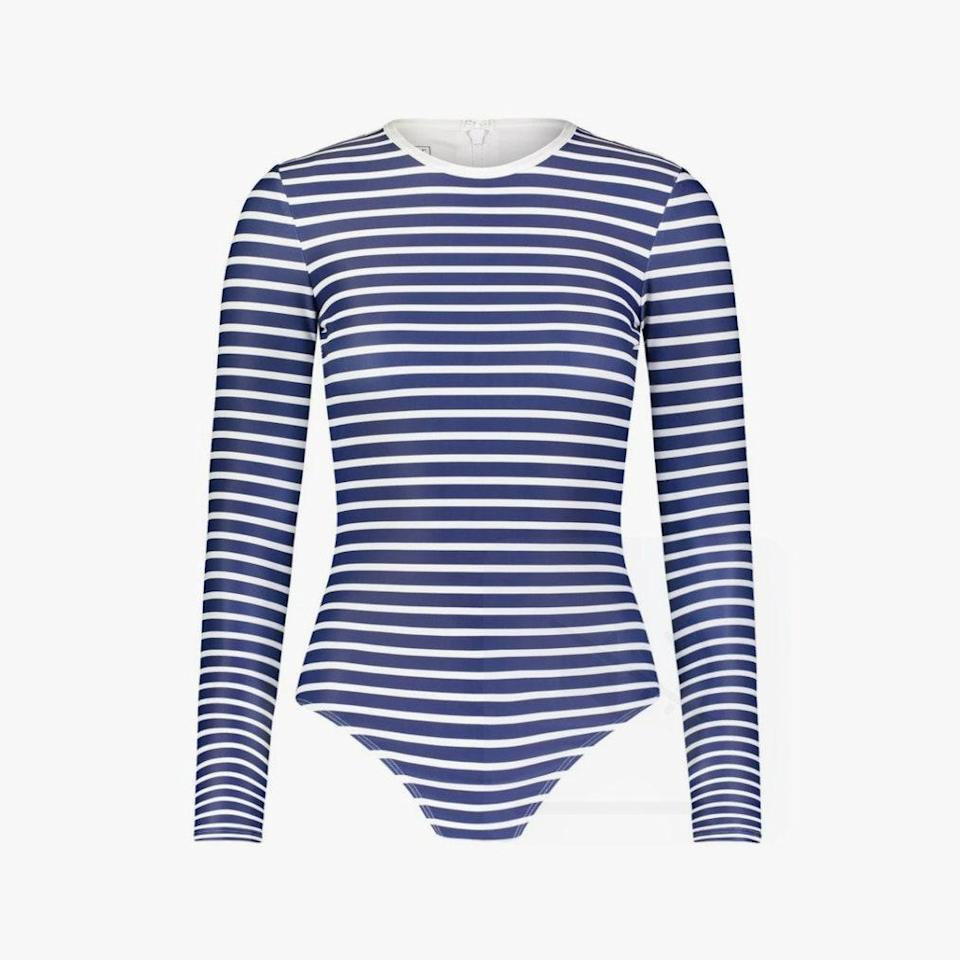 """$220, COVER SWIM. <a href=""""https://coverswim.com/collections/one-pieces/products/long-sleeved-swimsuit-navy-stripes"""" rel=""""nofollow noopener"""" target=""""_blank"""" data-ylk=""""slk:Get it now!"""" class=""""link rapid-noclick-resp"""">Get it now!</a>"""
