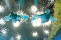 LONDON, ENGLAND - AUGUST 01: (L-R) Troy Dumais and Kristian Ipsen of the United States compete in the Men's Synchronised 3m Springboard Diving on Day 5 of the London 2012 Olympic Games at the Aquatics Centre on August 1, 2012 in London, England. (Photo by Clive Rose/Getty Images)