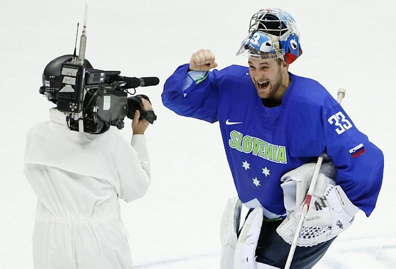 Slovenia goaltender Robert Kristan reacts to a television camera after shutting out Austria 4-0 to help his team advance to the quarterfinals of the men's ice hockey tournament at the 2014 Winter Olympics, Tuesday, Feb. 18, 2014, in Sochi, Russia