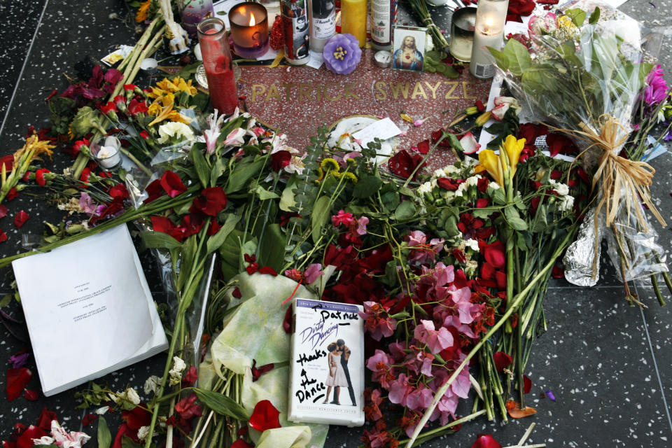 Flowers, candles, a DVD of the film Dirty Dancing on Patrick Swayze's start on Hollywood Walk of Fame. Source: Reuters